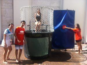 Teen volunteers have fun using the dunk tank during City Trekker Summer Camp 2014 at the Coral Gables Museum.