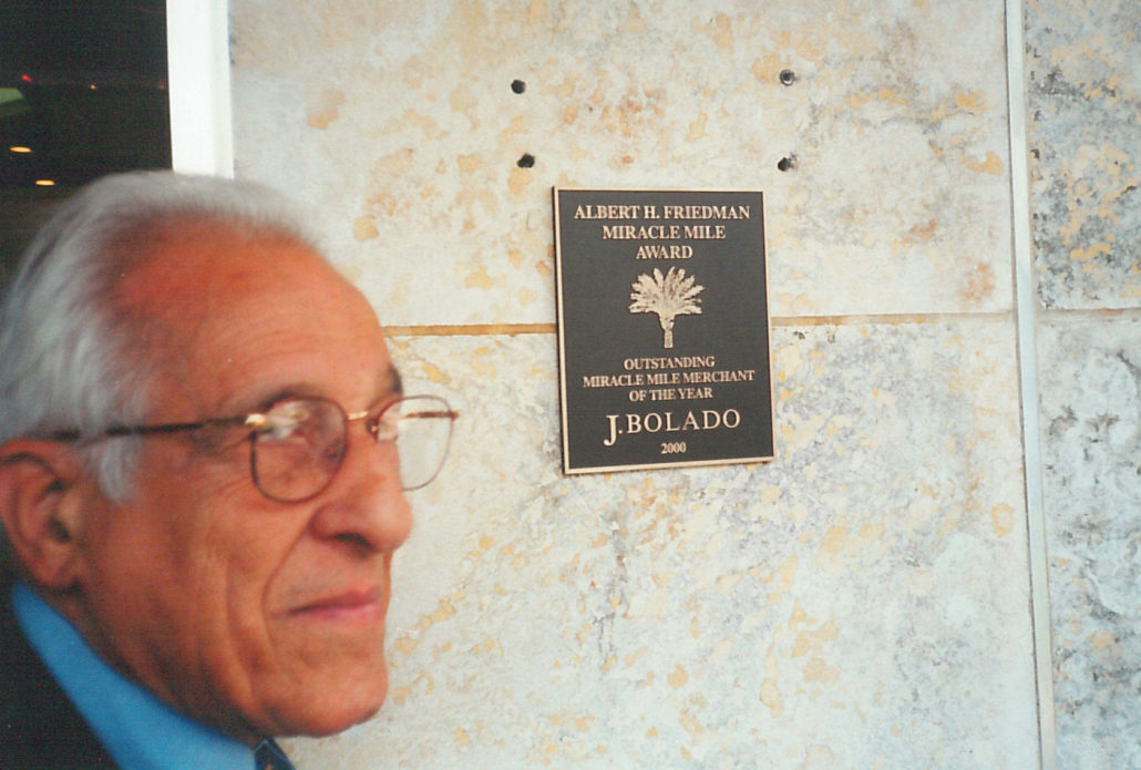 Albert Friedman in front of -Albert Friedman Award- given to Bolado's, 2000. Courtesy of Margot B. Friedman.